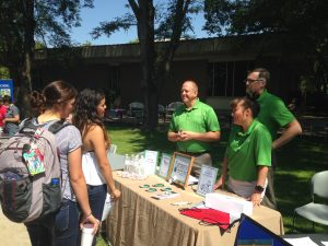 FB&T Staff meeting students at the CCC Block Party.